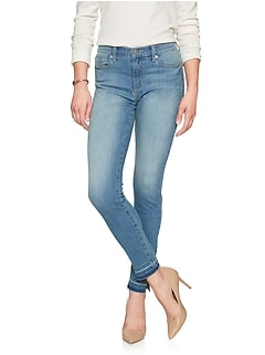 Petite Light Wash Mid Rise Side Slit Skinny Jean